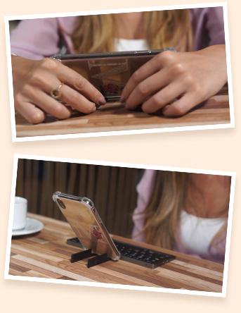 Smartphone apoiado no suporte do produto Teclado Bluetooth